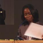Nyamko Sabuni vänder pappersmanus i talarstolen
